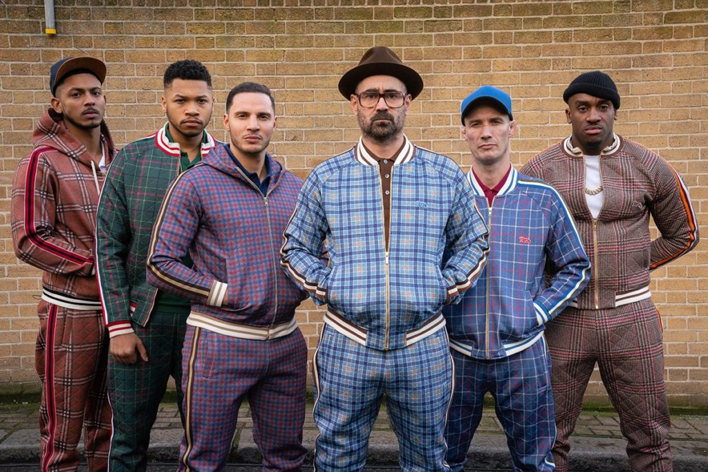 The boxers from the movie the gentlemen wearing tracksuit.